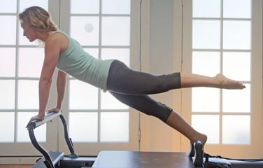 Pilates plank exercise on reformer