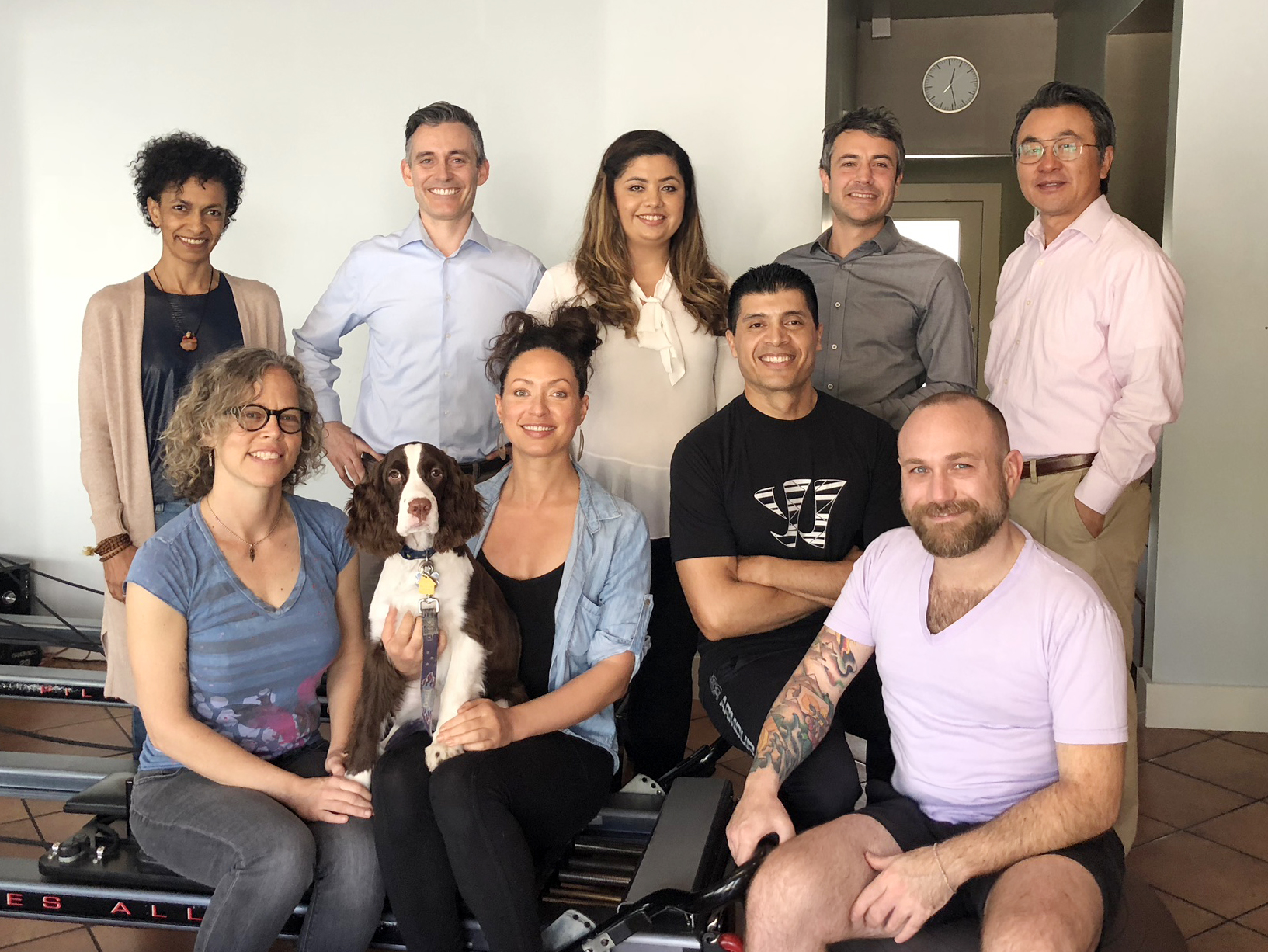 Image of all the staff at Live Well chiropractic with Dr. Gloin's friendly Dog Shelby